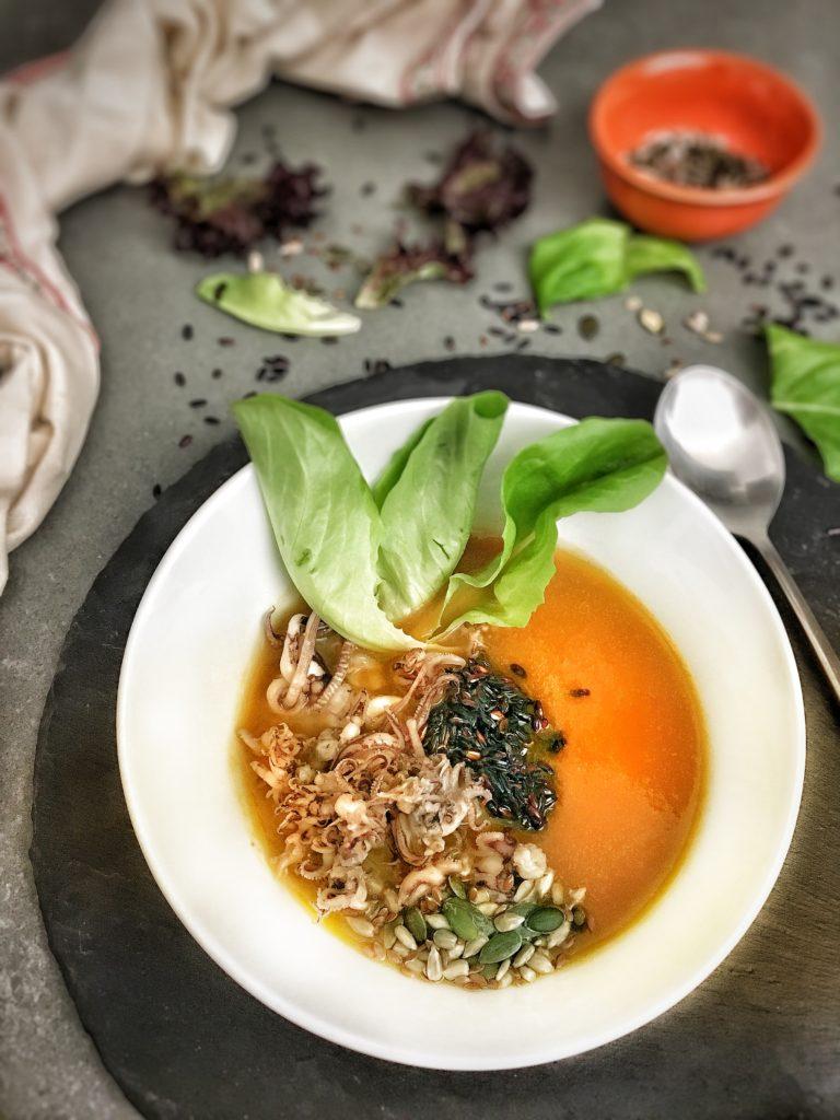 crema di zucca riso nero waxy e calamaretti
